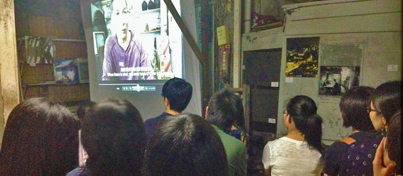 Public screening of students' documentaries in Pokfulam village in May 2014.